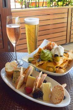 Unwind with Sunset Fare at Waiolu – Nachos, Gourmet Cheese Platter, Draft Beer, and Sparkling Rosé. Trump International Hotel Waikiki Beach Walk