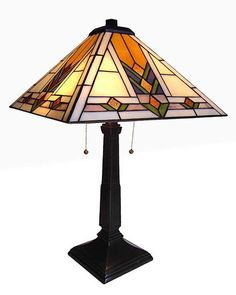 "The Arts & Crafts Tulip Stained Glass Table Lamp is 22.00"" in height. The resin base is 19.00"" x 9.50"" with a dark antique bronze finish. The shade is 8.00"" in height."