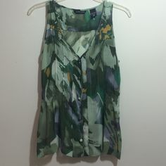 Floral sheer top Sleeveless sheer green floral top with button details. Cinches at waist. New York & Company Tops Blouses