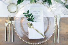 Jillian Murray and Dean Geyer wedding reception place setting wood table white runner gold flatware Dean Geyer, Jillian Murray, Reception Table, Reception Decorations, Wedding Reception, Jamaica Wedding, Wedding Bells, Wedding Plates, Wedding Charger Plates