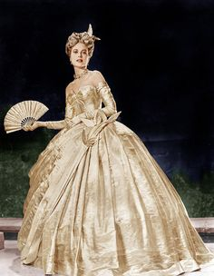"""Grace Kelly wearing Edith Head's gold masquerade ball gown in """"To Catch A Thief"""", 1954."""