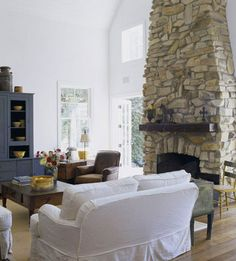 My dream home would have a great room with a vaulted ceiling and a stone fireplace that goes all the way up.  I also love the rough primitive mantel.
