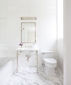 How to master the perfect white marble bath How to master the perfect white marble bathroom. View Upper East Side apartment we paired statuary marble with pure white thassos and crystal and nickel console sink from Waterworks. Marble Bathroom Floor, White Marble Bathrooms, All White Bathroom, Bathroom Flooring, Master Bathroom, Marble Floor, Vanity Bathroom, Waterworks Bathroom, Honed Marble
