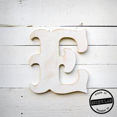 Carnival Style Wood E Letter Distressed Wall Decor by EdiesLab, $20.00