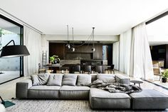 """Pietra Grigio marble enlivens the timber and concrete backdrop. This is a house whose """"dichotomy of raw and refined materials contrast and complement"""", says architect John Bornas."""