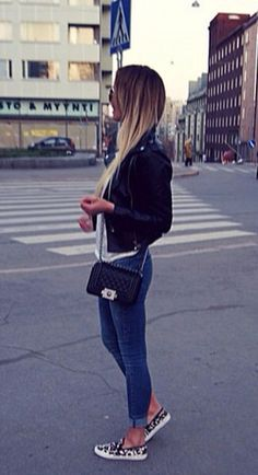 Jeans, white t-shirt, black leather jacket, leopard print Vans, black Chanel boy bag