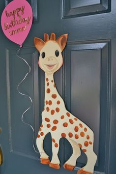 Sophie Giraffe First Birthday Party: draw out giraffe and place inside a yarn wrapped wreath on door. Sophie Giraffe First Birthday Party: draw out giraffe and place inside a yarn wrapped wreath on door. Giraffe Birthday Parties, Baby Girl First Birthday, Birthday Fun, First Birthday Parties, Birthday Party Themes, Birthday Ideas, Sophie Giraffe, Safari Theme Party, Baby Shower Giraffe