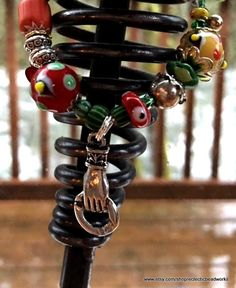 Steampunk Bracelet/Hand Crafted Beaded Bracelet/Whimsical Steampunk Bracelet/Lampwork Beaded Bracelet/Red Green Yellow Beaded Bracelet/Fun  Fun and whimsical Steampunk style lampwork glass beaded bracelet. I love these beads! They are so cool with so much