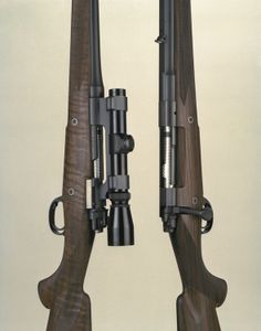On the left, one chambered for the time-tested 30-06 cartridge; and on the right an iron-sighted dangerous game rifle chambered for the 458 Lott cartridge. Photo by Ron Dehn.