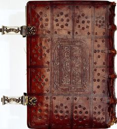 On this 15th century Dutch book of hours, via the National Library of the Netherlands, the date of the binding can be seen impressed in the center of the binding, as well as on the silver clasps (the hooks have sawn-out banderoles with the date, 1497. Hook and catch  are closed by means of a little pin that is fastened to the catch by a  chain): Retrieved by the web. Copyright by the National Library of the Netherlands