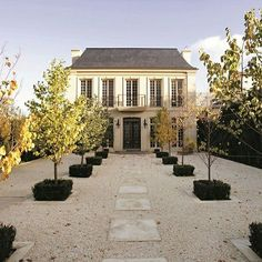 French. Gravel courtyard. Symmetry. Exterior.