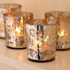 Tealight Holders.....love the speckled metallics in candle holders.