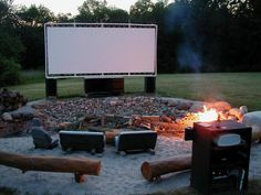 "Backyard Movie theater with fire pit - ""AWESOME!""...if only I can figure out how to work this into our back yard."