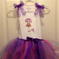 Lalaloopsy party dress I made for my daughter. Looked at several ribbon no sew tutu tutorials. Used a 4.00 tank from Walmart and an iron on transfer for the top. Then sewed the two together.