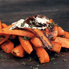 Burnt Carrots with Goat Cheese, Parsley, Arugula, and Crispy Garlic Chips Recipe  at Epicurious.com