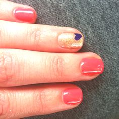 coral + gold accent nails.