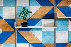 BAUX acoustic tiles combined with Vitsoe shelving to create a bold and graphic office interior. www.baux.se
