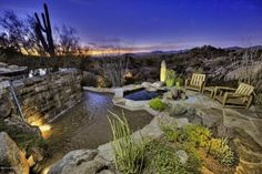 Sunset patio with waterfall, spa, and spectacular desert view...