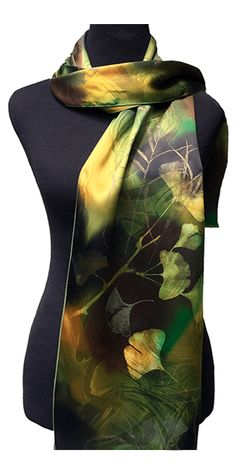 Hand-painted on 100% silk charmeuse, giving a luxuriously smooth, silky feel to this scarf. Approximate size: 61″ Long x 10″ Wide