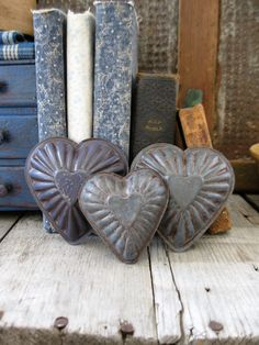 I painted these old tin molds with milk paint.  www.catspawprimitives.blogspot.com