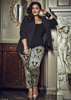 Allie from Inside Allie's World says her motto is 'Be Proud of the Woman You Are'. She wears jacquard trousers, £49, with stud shoulder jacket, £65