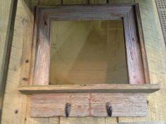 Barnwood mirror shelf with hooks.