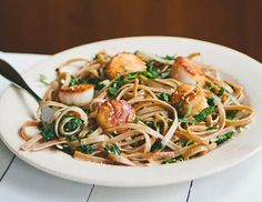 Combine scallops, fettuccine and kale to make this dish.