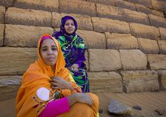 https://flic.kr/p/ebGqBe | Sudanese Women In Front Of The Pyramids And Tombs In Royal Cemetery, Meroe, Sudan | © Eric Lafforgue www.ericlafforgue.com