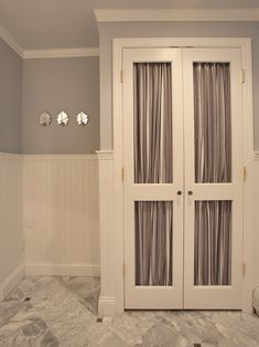 Closets Doors Design - (cut out panels and place curtains behind) - Great idea to revamp the louvered doors we have laying around ...