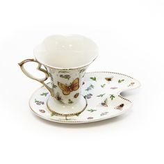Interior Place - Bugs and Flowers White Cobalt Porcelain Coffee Cup and Saucer (Gift Set of 2), 22.45 CAD (http://www.interiorplace.com/bugs-and-flowers-white-cobalt-porcelain-coffee-cup-and-saucer-gift-set-of-2/)