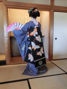 May 2015: maiko Tomitae with interesting tegara (cloth in ofuku hairstyle) and butterfly obi