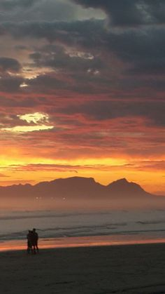 """May sunset on Strand Beach Road - with Table Mountain as backdrop for the """"strandlopers"""" (beach combers)...."""