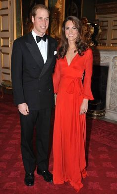 Wearing a red Beulah dress to attend a fundraising gala with Prince William in October, 2011.