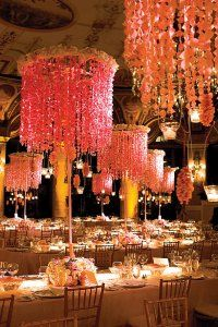 Chandeliers strung with floral leis and coral blossom floral. Preston Bailey Design. Photography by Jeff Greenough.