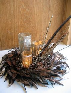 pheasant feather wreath surrounded by candles for the coffee table Feather Wreath, Feather Crafts, Feather Art, Peacock Wreath, Noel Christmas, Christmas Wreaths, Christmas Crafts, Christmas Decorations, Burns Night Decorations