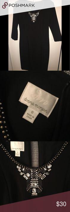 LITTLE BLACK DRESS with jeweled neckline Mid length LBD. 3/4 sleeves. Beautiful neckline design. Runs small/form fitting. Donna Morgan Dresses Midi