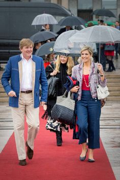 King WillemAlexander of the Netherlands and Queen Maxima of the Netherlands walk ahead of Princess Mabel of the Netherlands attend a lunch on the...