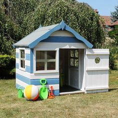 Who likes this Walton's Honeypot Snug Wooden Playhouse painted in these nautical colours? #playhouse #children #garden #nautical