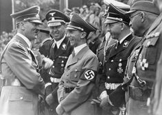 Adolf Hitler with Joseph Goebbels and others