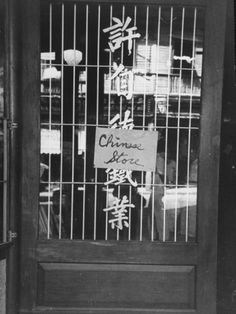 Chinese Store Owners Put Up Signs at Beginning of War So Not to Be Confused with Japanese