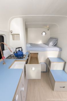quaint camper van conversion in blue, white, and light wood Caravan Makeover, Caravan Renovation, Van Conversion Interior, Camper Van Conversion Diy, Small Caravans, Motorhome Conversions, Van Bed, Sprinter Camper, Benz Sprinter