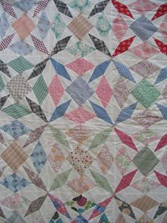 Here are my amazing vintage quilts. I think this one is from the 1940's or so, maybe earlier, looking at the fabric. Lots of shirtings. it's machine pieced and tied off-no quilting. look at the browns and oranges! It's pretty...