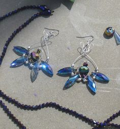 Beautiful, blue Swarovski Crystal Beads with custom-made wire design. Facets in these beads also flash purple. Goes perfect with white and