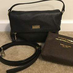 Kate Spade Pebbled Leather Purse Black Kate Spade pebbled leather purse. Flap closure with deep zipper pocket. Pink interior with one zipper and two slip pockets. Excellent condition. Approx 9in long, 7in high, 4in deep. Comes with shoulder strap and dust bag. kate spade Bags Crossbody Bags