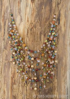 Cascading tiers of mismatched beads give this necklace a decidedly free-spirit feel.