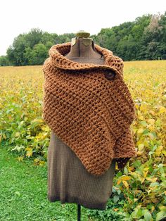 Love these big, wooden buttons. Ginger Wrap Extra Large Crochet Button Wrap Shawl by LazyTcrochet