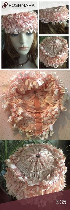 """Vintage 40's Collapsible Peachy Pink Ribbon Hat This unique and collectible collapsible hat is comprised of layered thin satiny grosgrain ribbons that create a dangling and fun effect. The top, which is  connected to a round top wire that's 5-1/2"""" in diameter, features an exquisite bullseye swirl. When in place, hat has a 4"""" crown drop and a 22""""'circumference.  In great preowned vintage condition. Smoke-free home Vintage Accessories Hats"""