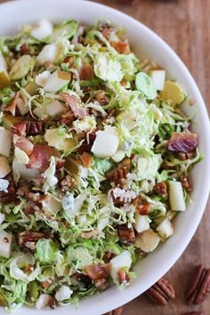 Brussels Sprout Chopped Salad with candied pecans, pears, blue cheese, bacon, and warm maple-bacon vinaigrette --- looking yummy . I love brussel sprouts Paleo Recipes, Great Recipes, Cooking Recipes, Simply Recipes, Avocado Recipes, Cooking Tips, Healthy Salads, Healthy Eating, Candied Pecans For Salad