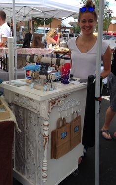 Looking good, Kelsey Novak of RockHill  Designs  Jewelry @ A Paris Street Market . Sporting a new customer check out stand from Junk Chic 5280. Portable counter made from salvaged kitchen cabinet,  architectural salvage, pressed tin ceiling tile, old door as counter top, shelves and drawer in back for storage. Best part......its on casters!!!