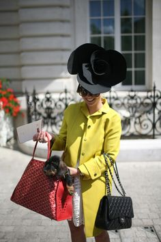 Love everything about this photo - especially the dog in the Goyard bag! (via WWD They Are Wearing: Paris Couture Week)